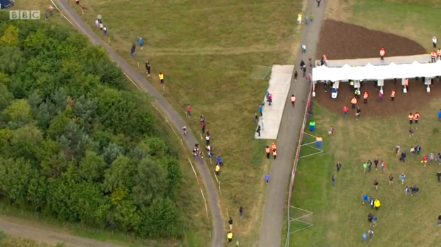 I am in the blue jacket just to the right of the riders in this aerial tv shot